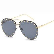 5f8a2cc27b 2018 nuevos hombres mujeres metal HD gafas de sol populares europeas y  americanas Rana espejo Fashion remachado anti ultraviolet.