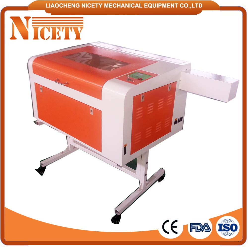 Hot sale cheap laser engraving machine price with electronic lifting table NT 4060B 400*600mm
