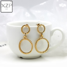 XZP Simple Fashion Gold Color Plated Geometric Double Big Round Earrings for Women Fashion Big Hollow Drop Earrings Jewelry(China)