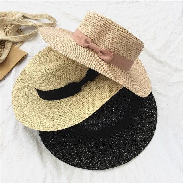 Wanita musim panas busur jerami topi diratakan Inggris mode topi pantai  wisata a2be455101
