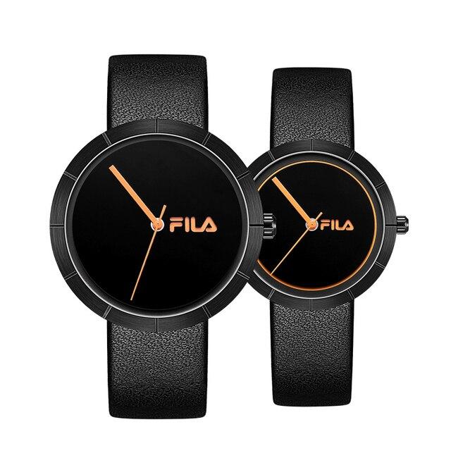 399badc060f Fila relojes hombres y mujeres parejas mesa simple moda tendencia deportes impermeable  reloj de cuarzo 620
