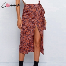 Conmoto التفاف القوس الحرير ميدي تنورة النساء انقسام مثير ليوبارد طباعة عالية الخصر التنانير عالية أزياء الشتاء Feminino تنورة