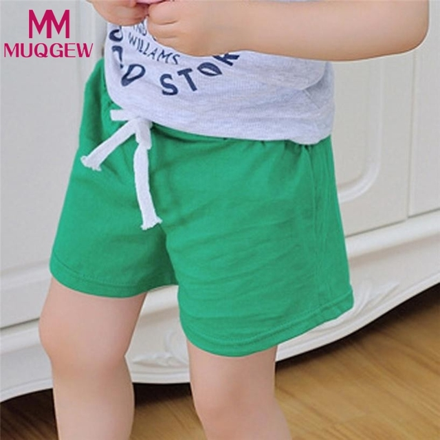 f4c79d620e US $1.76 43% OFF Boys Shorts Kids Clothes 2018 Children Summer Beach Shorts  for Boys Girls Clothing Solid Color Cotton Unisex Baby Shorts Fille-in ...