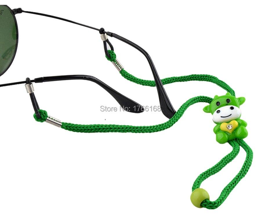 150a639026 Réglable enfants Nylon lunettes de soleil cordon coloré anti dérapant enfant  lunettes sangle cou cordon avec des extrémités en Silicone dans Accessoires  de ...