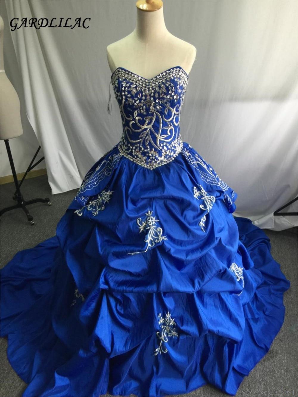 새로운 저렴한 로얄 블루 자수 Quinceanera 드레스 2019 가장 무도회 가운 가운 Ruffles 스위트 16 드레스 Vestidos 드 15 Anos