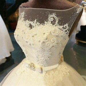 Image 4 - חלול חזרה אשליה בציר אורגנזה חתונה שמלת כדור שמלת כלה שמלה לבן ללא שרוולים משפט רכבת חתונת שמלות WX0008