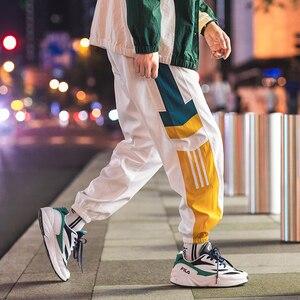 Image 2 - Joggers Sweatpants Men Casual Striped Pants Fashion Loose Track Pants Men Sweat Pants Sports Japanese Streetwear White Black