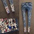 Calças de ganga Para Mulheres 2017 Outono Nova Chegada de Moda Beading diamante Buraco fazer O Velho Magro Calças Jeans Femininas Lápis Calças Jeans Pés Calças