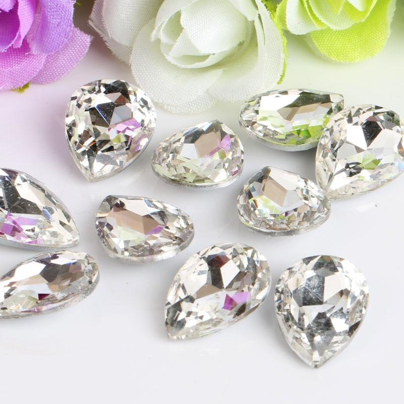 قطرة بيضاء على شكل زجاج شفاف أحجار الراين السفلية تنطبق على الملابس الديكور وديي المجوهرات 50pcs / pack