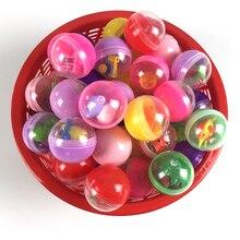 Jouet de capsules de boule de Surprise en plastique transparent de 10 pc/paquet avec le distributeur automatique de jouet de figure différente à lintérieur dans des boules doeufs de Shilly