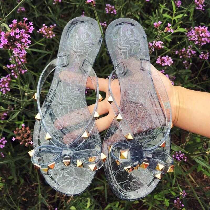Hot 2018 แฟชั่นผู้หญิงรองเท้าแตะพลิกฤดูร้อนรองเท้าชายหาด Rivets โบว์แบนรองเท้าแตะ jelly รองเท้ารองเท้าแตะขนาด 36-41