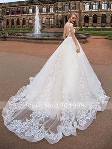 Image 2 - Liyuke תחרה אונליין חתונה שמלות אפליקציות סקופ צוואר שרוולים גב פתוח סקסי אשליה טול קפלת רכבת Vestido דה novia