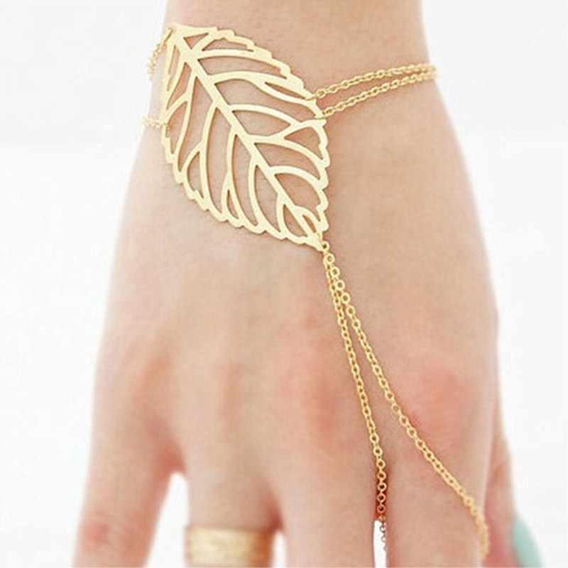 チャーム中空葉ブレスレット FingerRing とスレーブチェーンハンドハーネス女性ゴールドカラー Pulseras Mujer ビジュー卸売