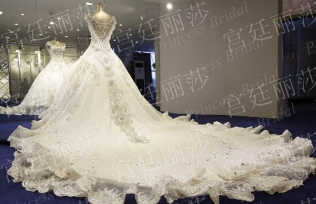 Luxurious Ball Gown V Neck Crystal Beaded Cathedral/Royal Train Tiered Skirt Long Train Wedding Dress Gown With Appliques MF422