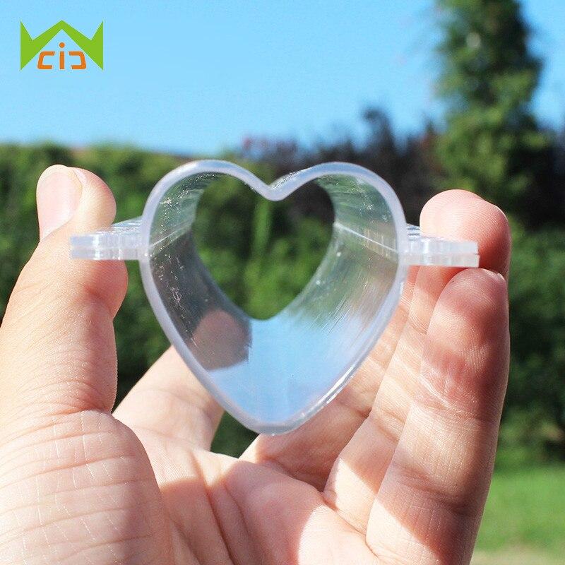 WCIC Pepino Sandía Frutas Crecimiento Crecimiento formando Molde Estrella / Plástico en forma de corazón transparente para jardín Bonsai