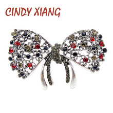CINDY XIANG 2 Colors Available Rhinestone Bow Brooches For Women Vintage Fashion Hollow-out Flower Bowknot Pin New Design Gift