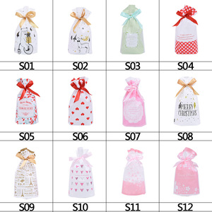 Image 2 - 5pcs Merry Christmas Candy Bag Plastic Drawstring Bags Silk Ribbon For Birthday Wedding Party Decora Kids Gift Wrapping Supplies