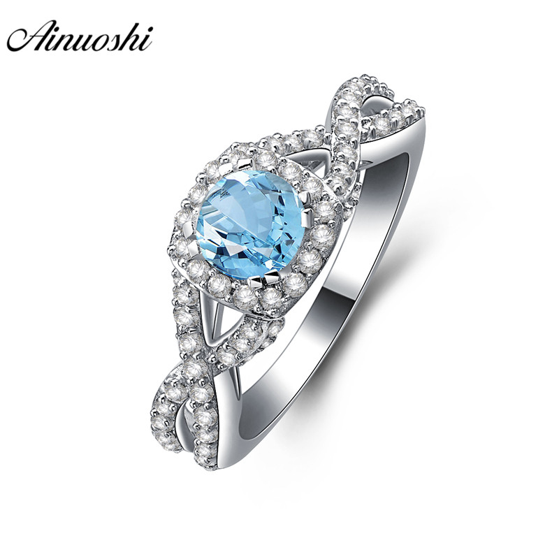 AINUOSHI Natural Blue Topaz Ring Engagement Wedding Ring 0.6ct Round Cut Gem Twisted Halo Ring 925 Sterling Silver Women Jewelry ainuoshi trendy 925 sterling silver women wedding engagement ring halo 0 5ct emeralded cut ring aniversary gifts anillo de plata
