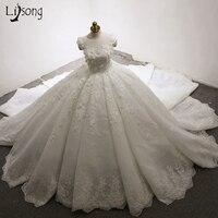 Dubai Luxury Wedding Dresses 3D Flower Appliques Lush Ball Gowns Pleated Bridal Dress Casamento Royal Train
