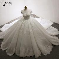 Dubai Luxury Wedding Dresses 3D Flower Appliques Lush Ball Gowns Pleated Bridal Dress Casamento Royal Train Robe De Mariee 2017