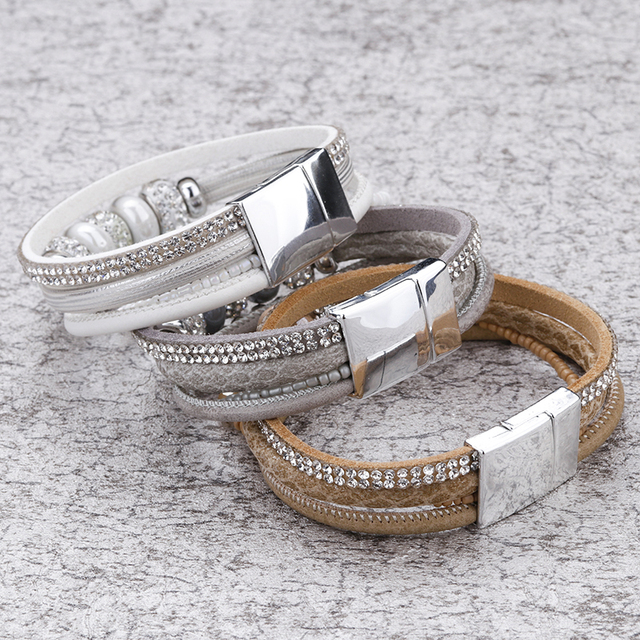 three Leather And Bead Bracelet's on store display