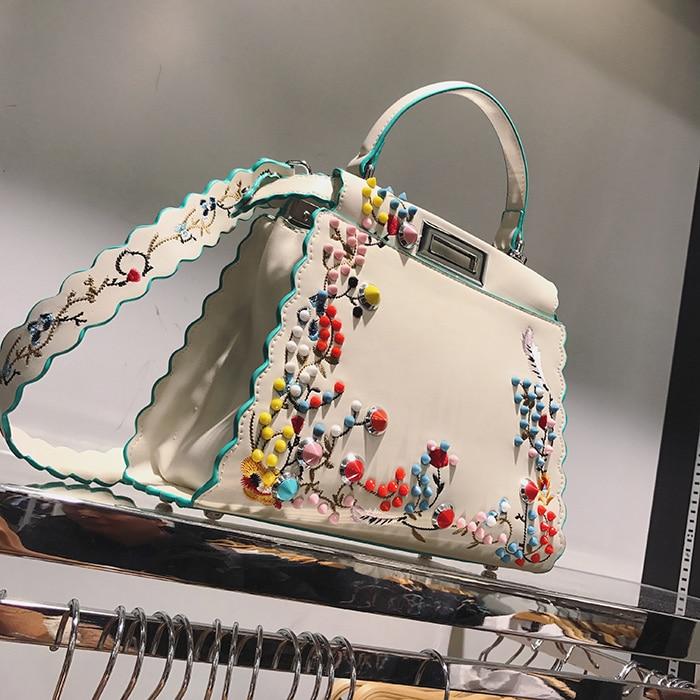 купить 2017 Women Peekaboo Bag Embroidery Famous Brand Designer Tote Big Handbag Shoulder Bags Printing Rivet Waves Luxury Bags Purse дешево