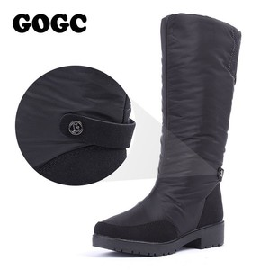 Image 1 - GOGC Winter Boots Women 2019 autumn winter woman High Boots Waterproof Brand Women Shoes Warmful Winter Shoes Women Flat 9893