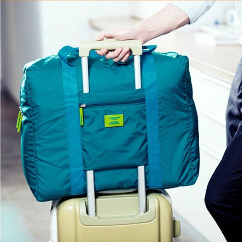 一般的なファッション防水折りたたみトラベルバッグユニセックス大容量ナイロントロリーコンプリートパッケージトラベルトートハンドバッグ
