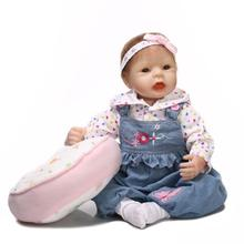 22 inch Realistic Gentle Touched Vinyl Reborn Girl Doll Toy as Girls Birthday Gift Jeans Dressed with Pillow