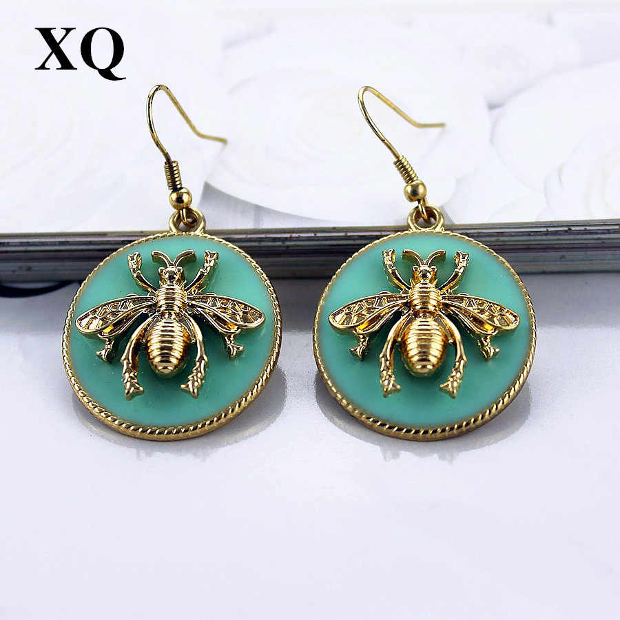XQ Free shipping 2015 European and American fashion jewelry and gold earrings female bee light green earrings for women
