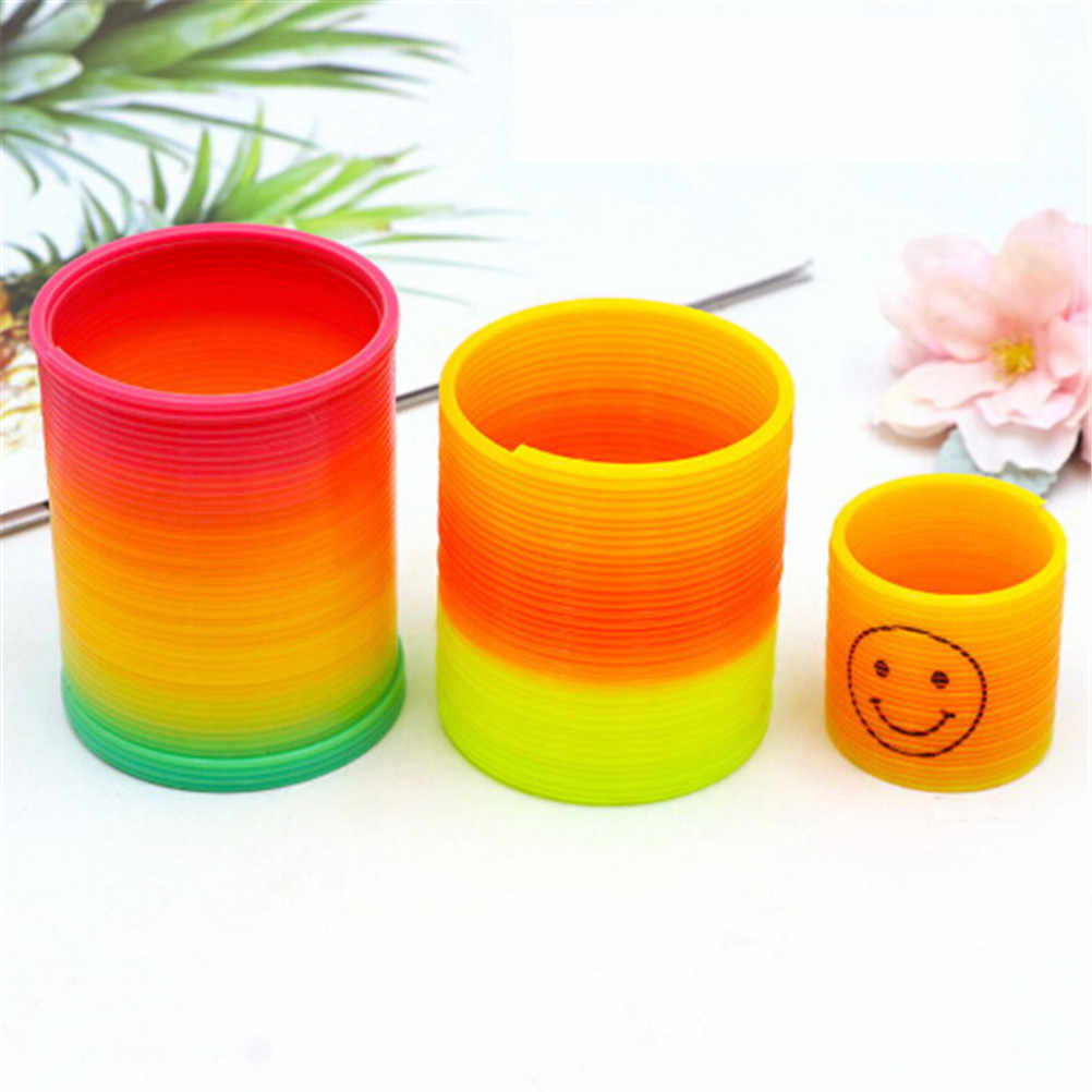 10pcs/set Kids Magic Plastic Smile Rainbow Spring Colorful Children Circle Coil Elastic Ring For Christmas Birthday Gifts Rated