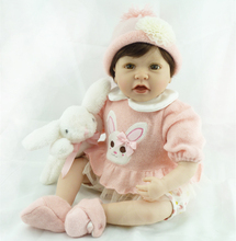 22″ Soft Silicone Vinyl Brown Eyes Lifelike & Realistic Baby Reborn Doll Christmas Gift Doll Toy in Pink Knitted Clothes