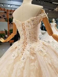 Image 4 - LSS076 trasporto libero veloce abiti da sposa al largo della spalla sweetheart fiori abito di sfera abiti da sposa con il treno lungo reale prezzo