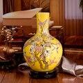 Jingdezhen famille rose cerâmica vaso amarelo com pássaro e flor de ameixa projeto para hom decoração