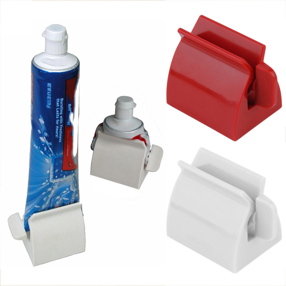 Rolling tube toothpaste squeezer toothpaste easy dispenser for Bathroom accessories stand