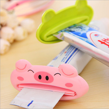 Купить с кэшбэком 2pc/Lot Cute Cartoon Squeeze toothpaste device Toothpaste Dispenser facial cleanser Squeezer Clip