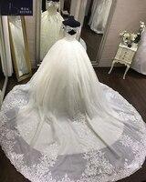 Vestido دي noiva قبالة الكتف الرباط فستان الزفاف الكرة ثوب طويل الأكمام يزين فتح العودة مثير فستان العروس