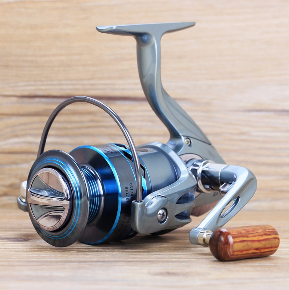 FREE SHIPPING ZF Hot Sale 2000-7000 Ice carp fly ocean rock spinning gapless fishing reel 13 Ball Bearings front drag wood knob