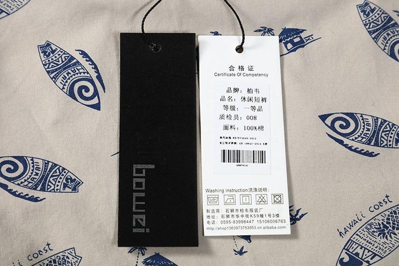 bordado logo calças curtas surf
