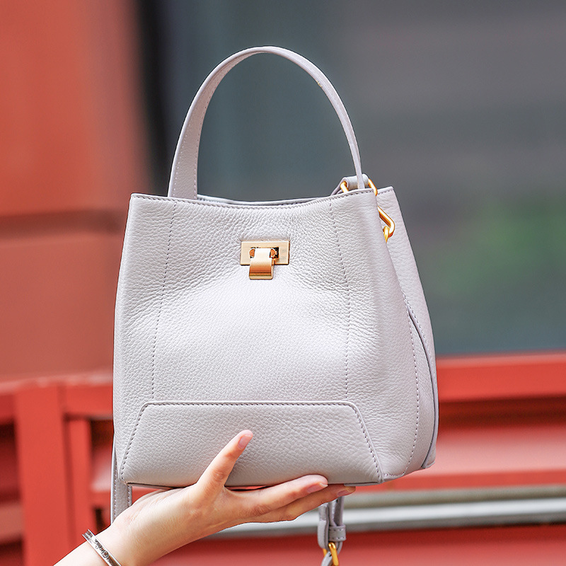 Elegant and refined solid color lychee leather female bucket bag large capacity lock and open the door of women leather handbags elegant women s evening bag with metal and solid color design page 6