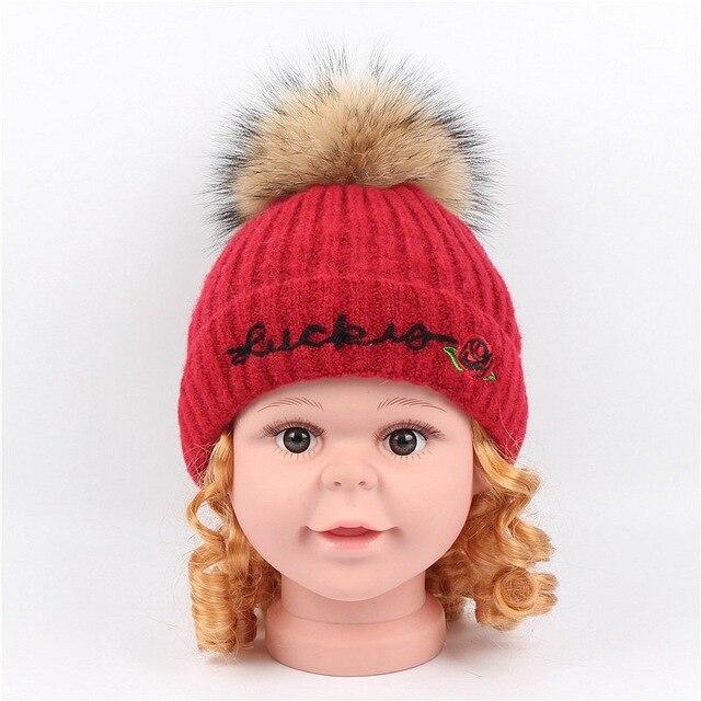 The new children rose Monogram embroidery knit cap Korean cute baby raccoon  fur ball wool cashmere hat e3b16d50daa