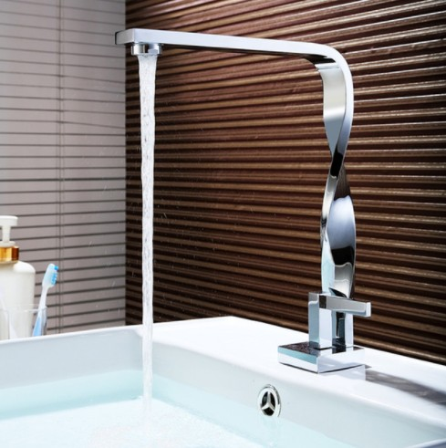 цена Brass Chrome Bathroom Basin Faucet Hot and Cold Water Faucet Deck Mounted Basin Mixer Tap Modern Style Bathroom Product