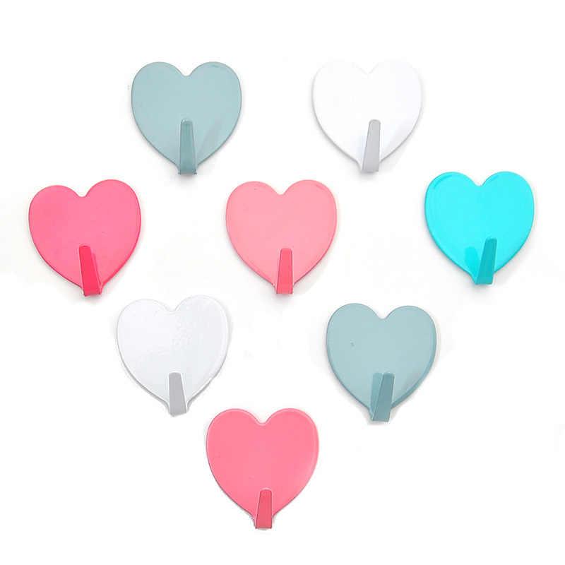 1 sztuk w kształcie serca metalowe haki wieszak na ręczniki stojaki szata wieszaczki ściany haki do przechowywania do kuchni łazienka klej Wieszak ścienny