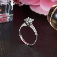 Jewellwang Hot Sale 18k White Gold Rings 1 Carat Classic Round Moissanites Simple Four Claw Inlaid Engagement Rings For Women