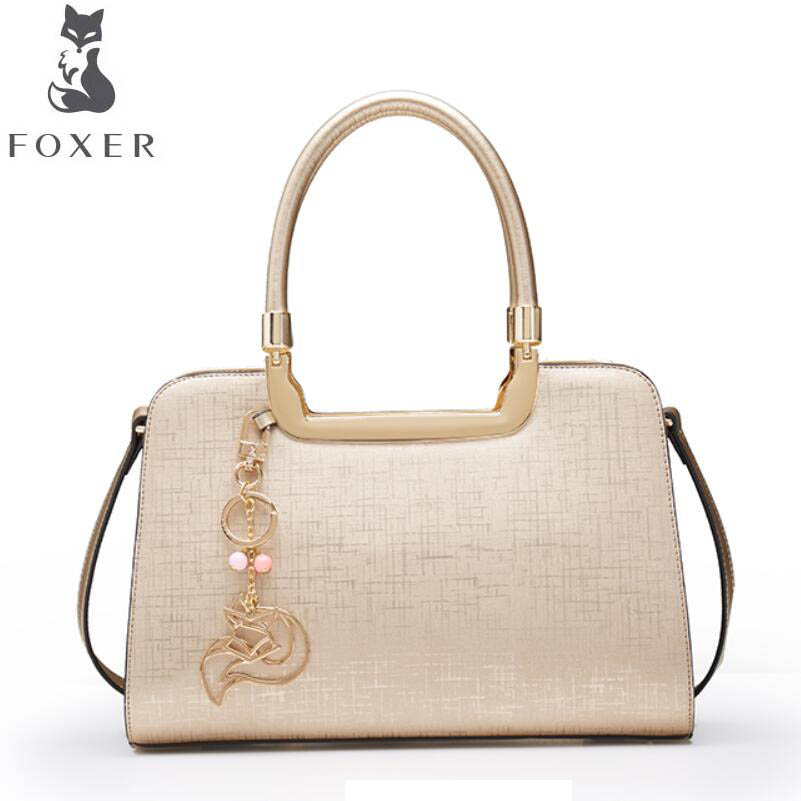 FOXER2018 high-quality fashion luxury brand new hand carry ladies shoulder bag leather Europe and the United States Messenger Ba hot fashion europe and the united states fashion oil wax kraft handbag vertical section zipper multi color ladies shoulder messe