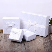 Купить с кэшбэком 2018 New Gift Box 12 Pcs/Lot Wholesale White Bowknot Kraft Paper Favour Boxes Fashion Design Bulk Ring Bracelet Jewelry Box