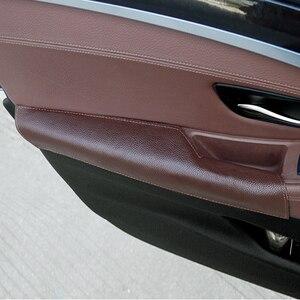 Image 1 - Dla BMW serii 5 F10 F18 2011 2012 2013 2014 2015 2016 2017 kierowca samochodu boczne podłokietnik drzwi uchwyt, gałka krowy skóra pokrywa