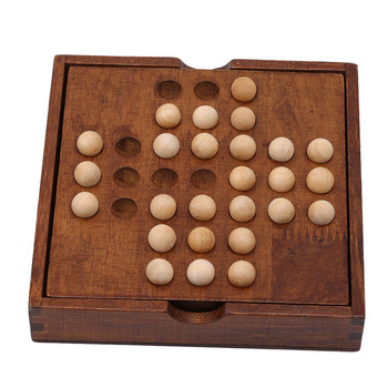this image shows the wooden solitaire board game all ready in play as some balls have already been removed