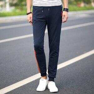 5XL Mens Casual Pants Cotton Sweatpants Men Joggers Striped Pants Gyms Loose Sweat Pants Bodybuilding Tracksuit Bottoms Elastic