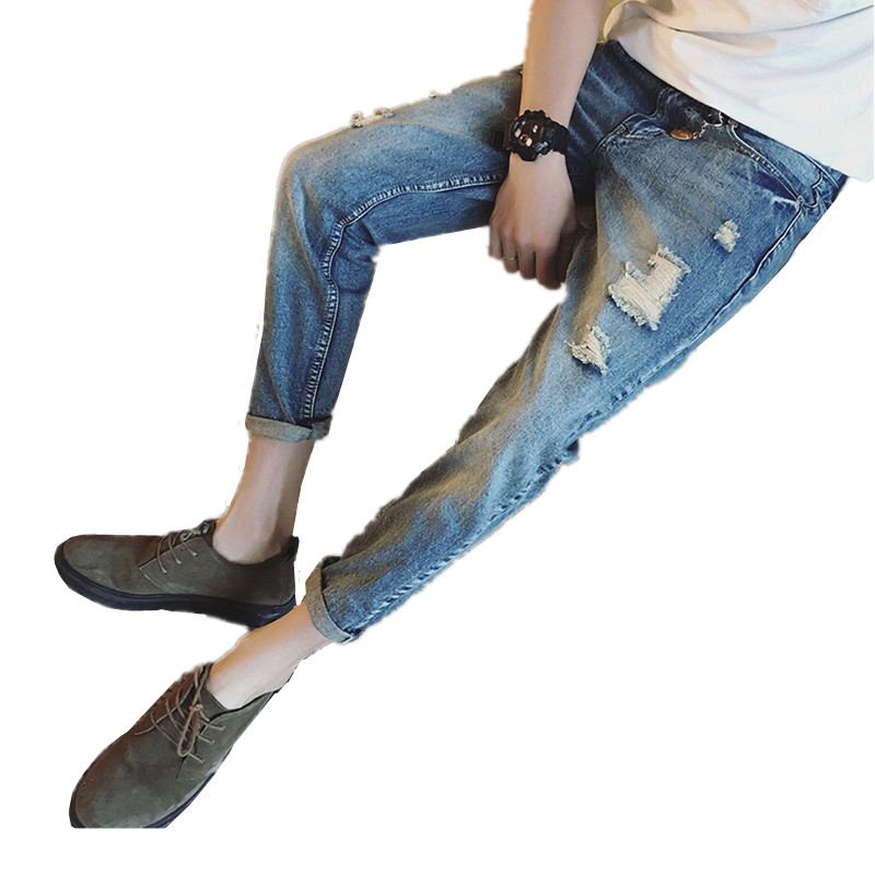 XT1050 The new spring 2017 young male feet han edition cultivate one's morality type hole haroun nine points jeans tide